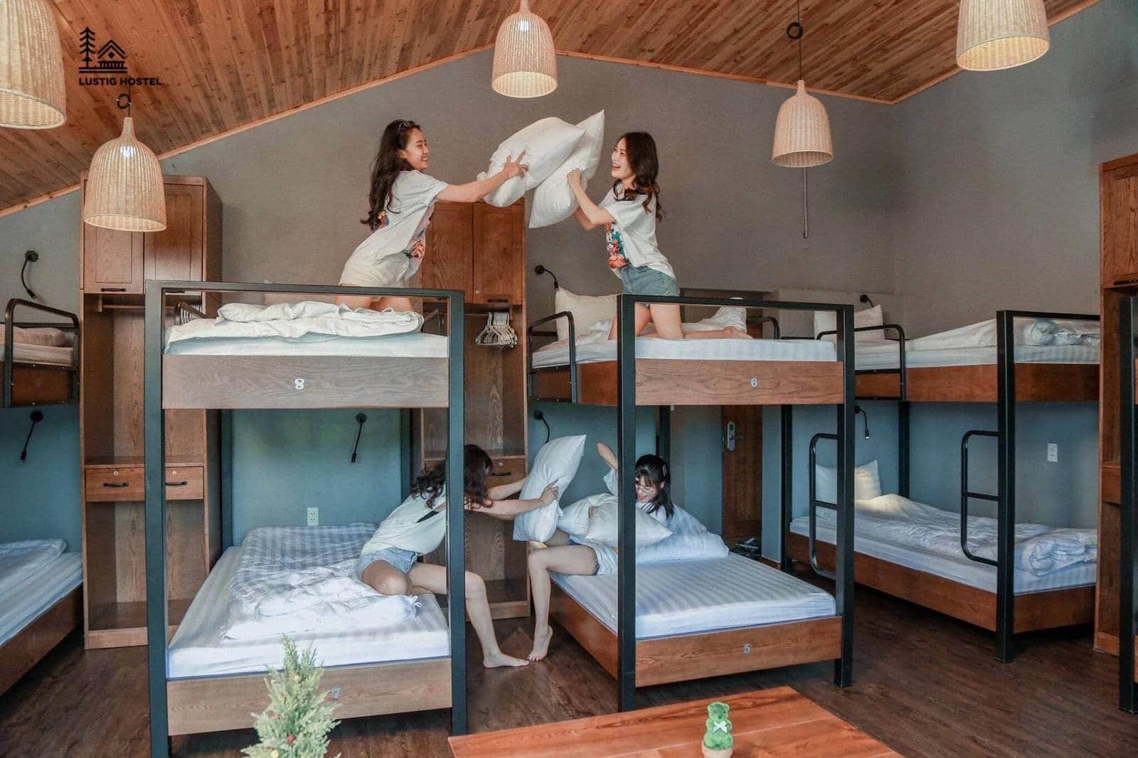 Image of girls having a pillow fight at Lustig Hostel in Sapa Vietnam