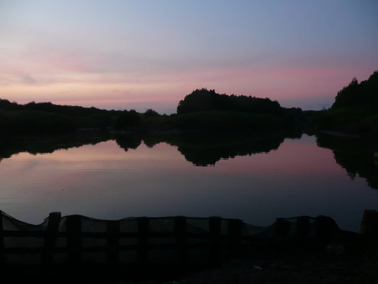 Image of the sun setting over a shrimp pond in Mui Cao Mao in Vietnam