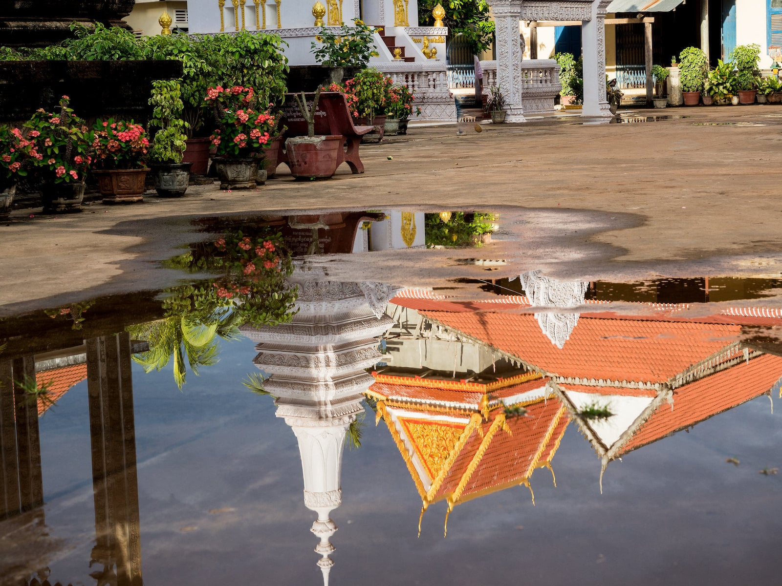 Image of a pagoda reflecting in a pool of water in Vietnam