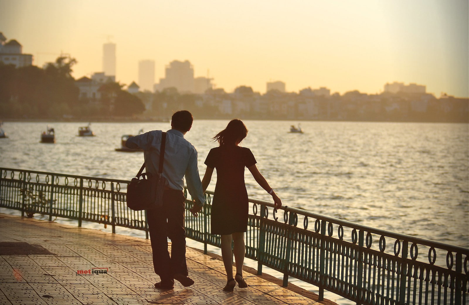 Image of a couple walking along the West Lake in Hanoi Vietnam