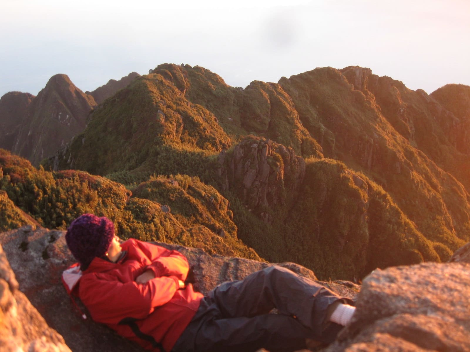 Image of a hiker looking out at Fansipan in Vietnam