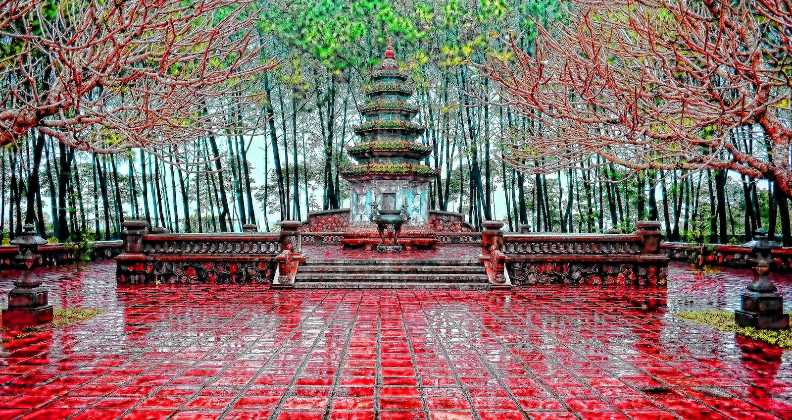 Image of a red topaz temple in Hue, Vietnam after rain