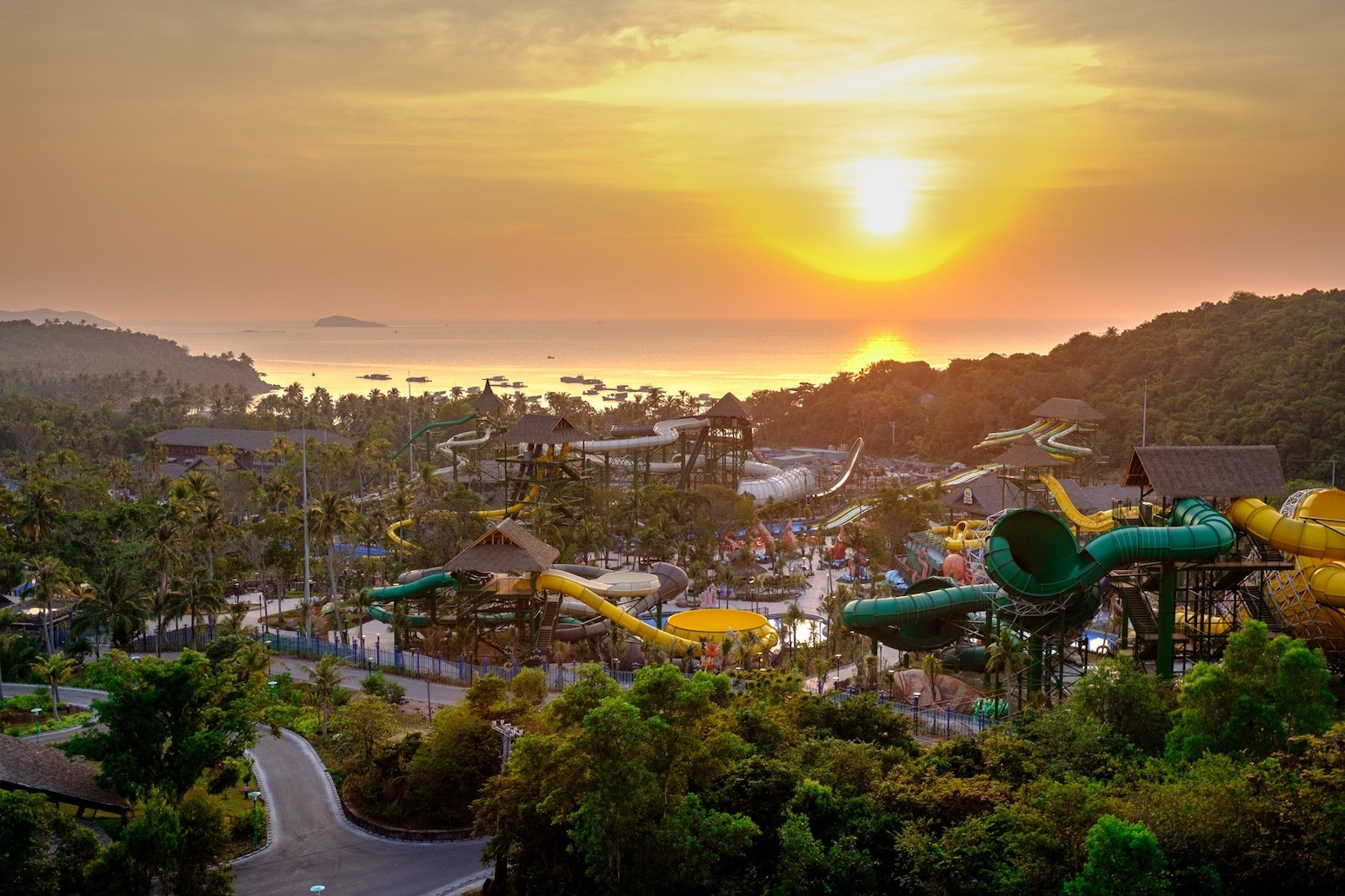 Image of the sun setting behind the waterslides at Sun World Hon Thom Nature Park