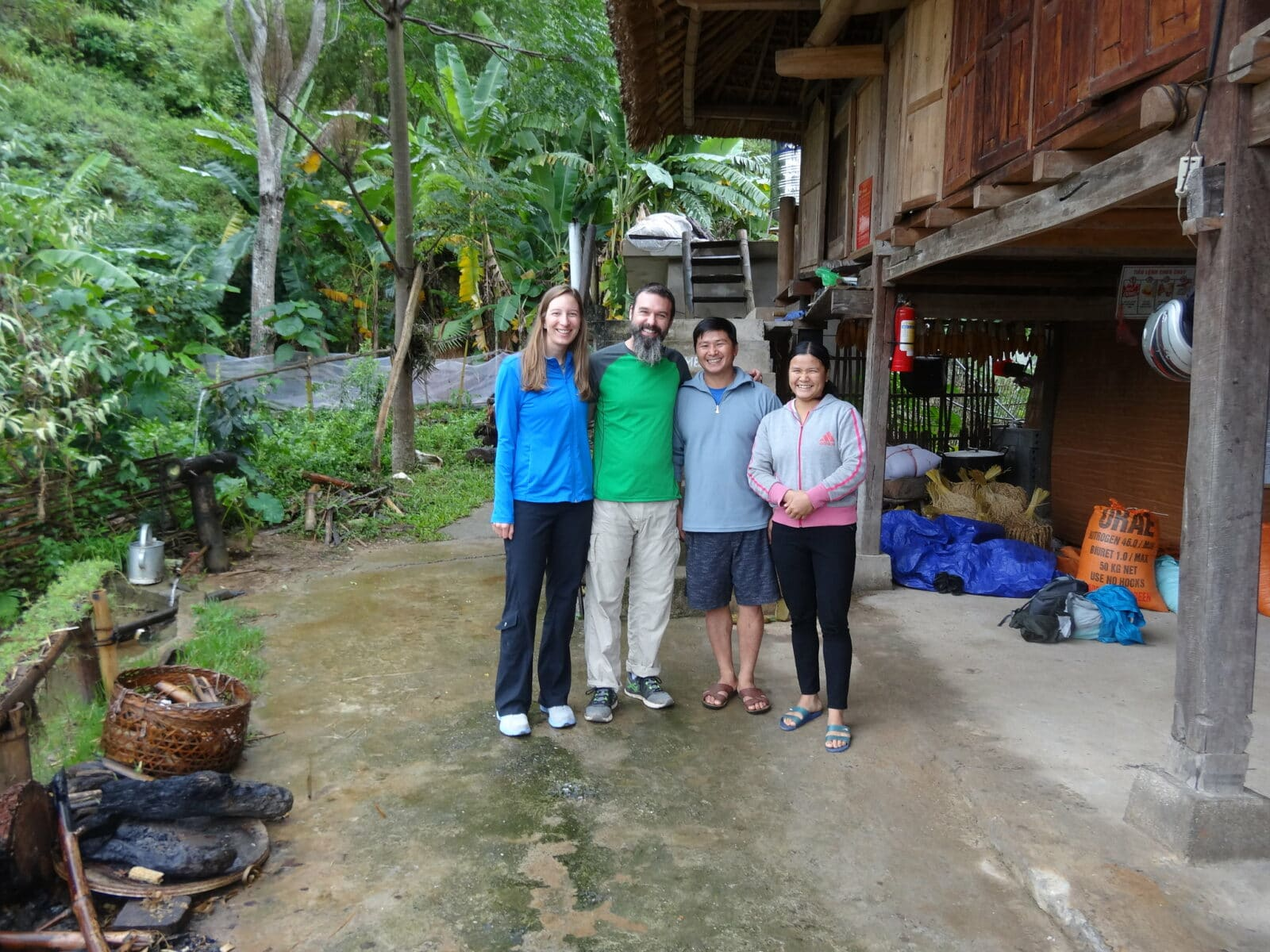 Image of a couple with their homestay hosts in Ha Giang, Vietnam