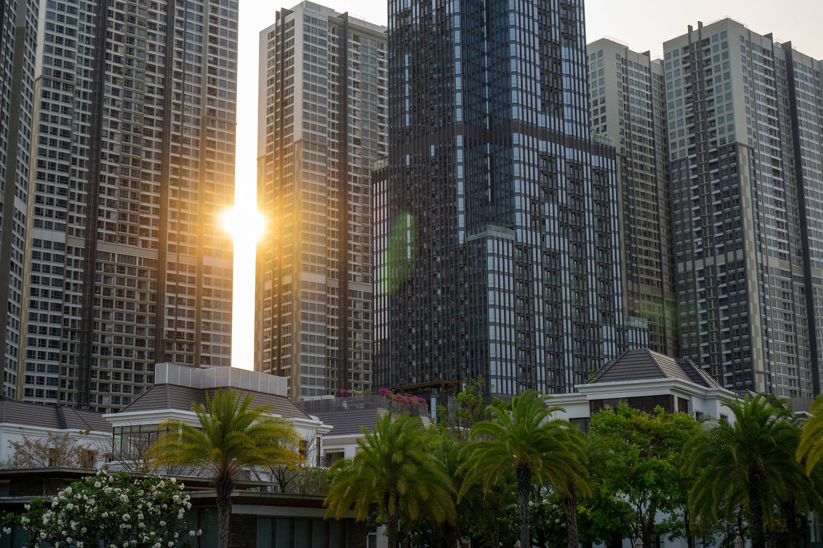 Image of the sun setting behind Vinhomes Apartment in HCMC, Vietnam