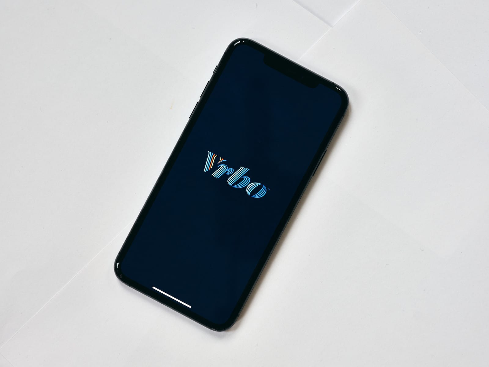 Image of the VRBO logo on a phone