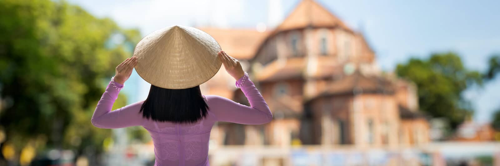 Vietnam Culture Notre Dame Cathedral Woman in Ao Dai HCMC