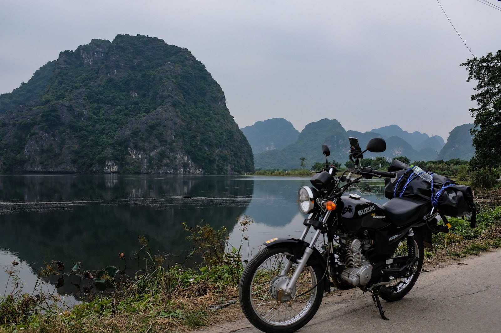 Image of a motorbike in Ninh Binh with karsts in the background