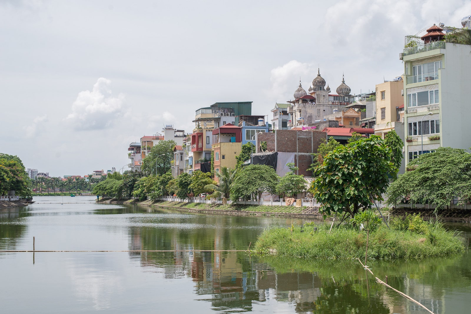 Image of buildings by a river in Vietnam